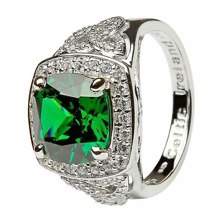 Showcasing a large square cut green CZ and surrounded by sparkling CZ's this Irish Ring is dramatic and so eye catching. Adding to the drama are CZ encrusted Trinity knots on each side band. Sizes 6 - 10 including half sizes.